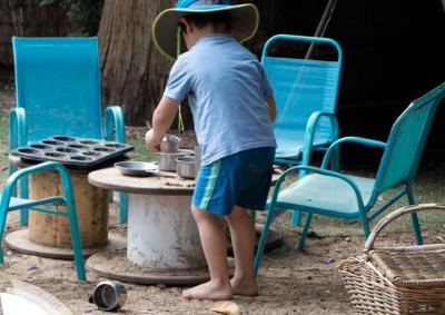 A child playing with pans and pots outdoor