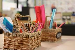 Cane baskets filled with pencils and rulers