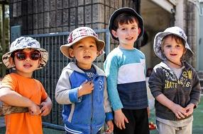 Group of boys with hats standing in line