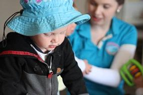 Child at Goodstart Learning with a carer