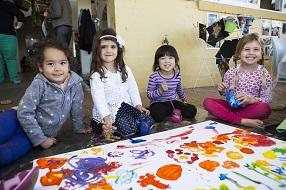 Children painting and smiling