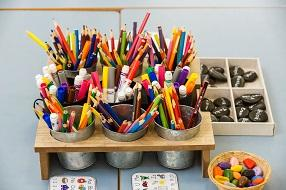 Desk arrangement with colourful pencils