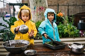 Two kids playing outside rain cold