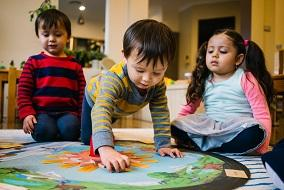 Children playing with map at service