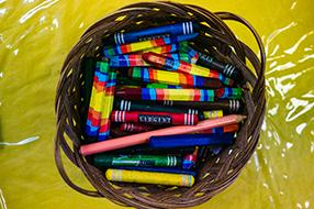 Basket of colourful crayons