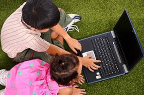 Two children looking at laptop