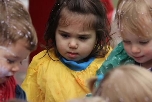 close up of children at a messy table activity